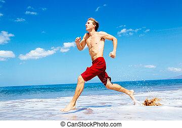 Athletic Man Running on Beach