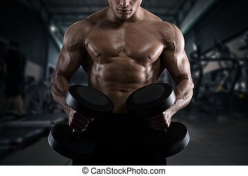 Athletic man training biceps at the gym - Athletic muscular...