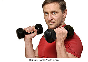 man with a dumbbells - Athletic man with a dumbbells over ...