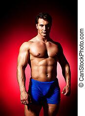 athletic - Portrait of a handsome muscular bodybuilder ...