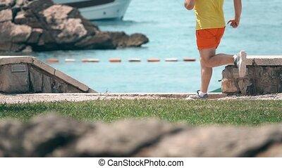 Athletic runner's feet, super slow motion shot - Athletic...