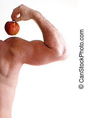Athletic sexy male body builder holding red apple - Red...
