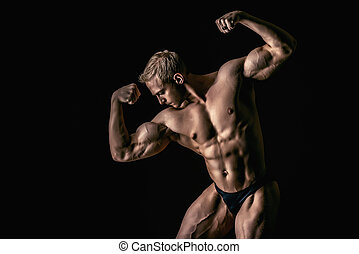 athletic strenght - Handsome muscular athletic man posing...