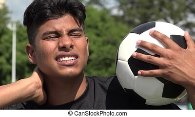 Athletic Teen Male Soccer Player Soreness