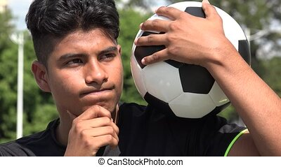 Athletic Teen Male Soccer Player Thinking Deep Thought