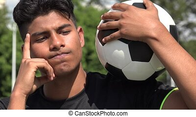 Athletic Teen Male Soccer Player Thinking