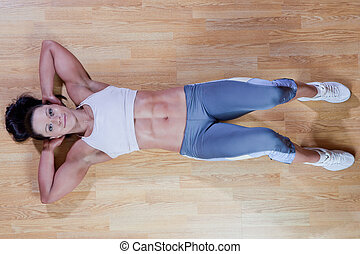 Athletic trainer shows examples of exercises in the gym