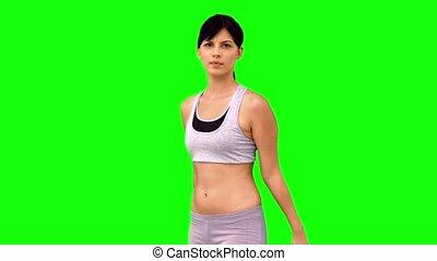 Athletic woman doing marital arts p