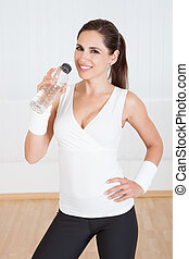 Athletic woman drinking water - Attractive shapely athletic ...