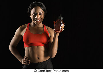 Athletic woman holding water bottle.