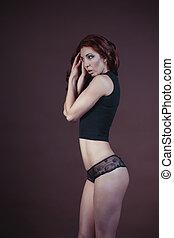 Athletic woman in black shirt. Studio shot