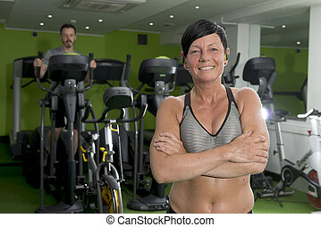 Athletic Woman in Crop Top with Crossed Arms in Gym