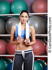 Athletic woman in fitness gym