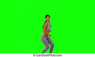 Athletic woman jumping and posing o
