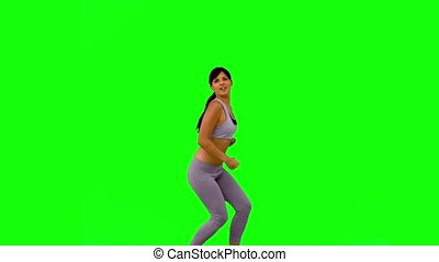 Athletic woman jumping and posing o