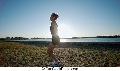 Athletic Woman Jumping In Sneakers, Sunlight