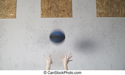woman performing wall ball exercise - Athletic woman...