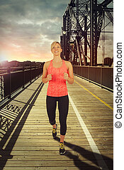 Athletic woman running outdoor