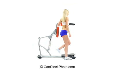 Athletic woman shows exercise on trainer