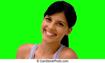 Athletic woman smiling at camera on
