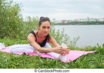 fitness woman stretching back hamstring leg muscles