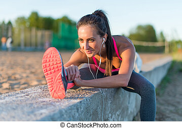 Athletic woman stretching her hamstring, legs exercise training fitness