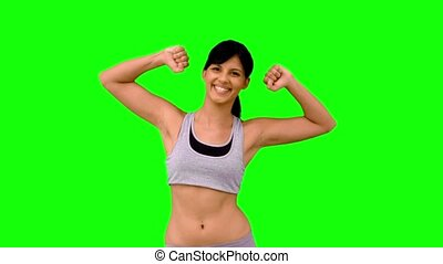 Athletic woman tensing her arms on