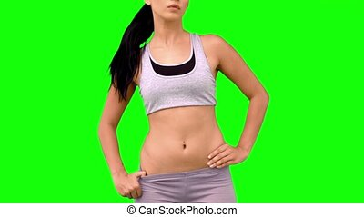 Athletic woman tossing hair on green screen
