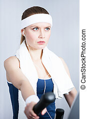 Athletic woman training on gym training in gym