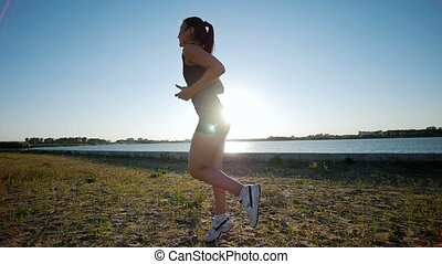 Athletic Woman Trains Near The River