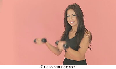 Athletic woman using dumbbells