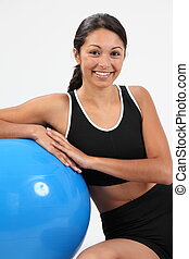 Athletic woman with exercise ball
