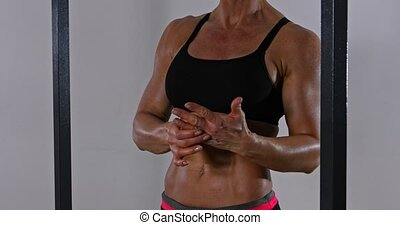 Athletic woman with musculed abdomen