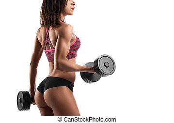 Athletic woman working out with dumbbells