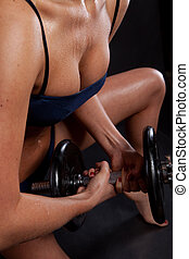 Athletic young lady doing workout