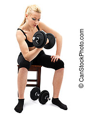 Athletic young lady working out with weights