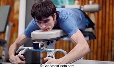 Athletic young male does exercises at gym. 1920x1080 -...
