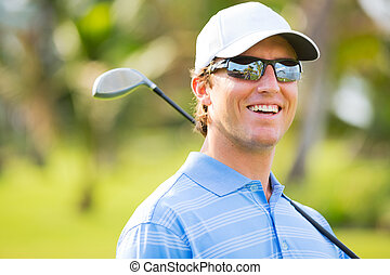Athletic young man playing golf, Portrait of Golfer on...