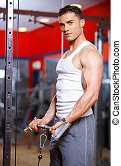 Athletic young man working out in a gym