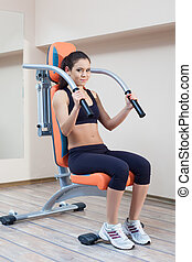 Athletic young woman in gym