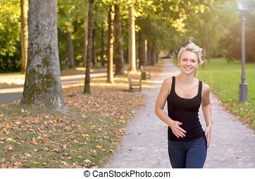 Athletic young woman jogging in a park