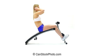 Athletic young woman on exerciser