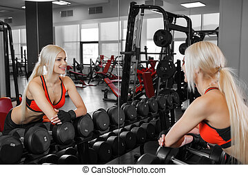 athletic young woman resting during exercise