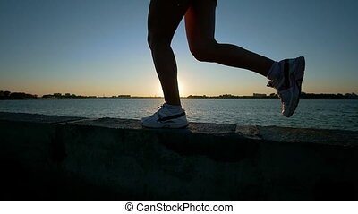 Athletic Young Woman Running In Sneakers On The Waterfront