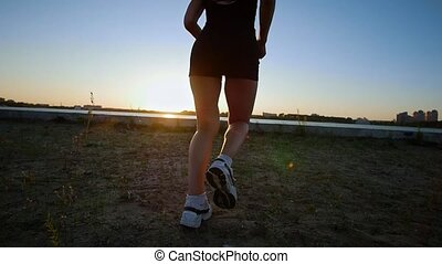 Athletic Young Woman Runs To The River
