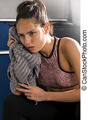 Athletic Young Woman Wiping Her Face with a Towel