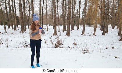 athletic young woman with protein shake bottle