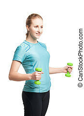 Athletic young woman works out with green dumbbells