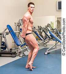 athletically built sportsman in the gym