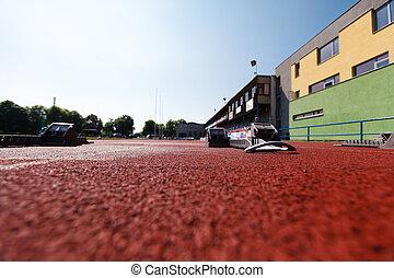 Athletics starting blocks. - Athletic track. Athletics...